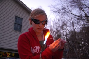 Jeannette making glass beads on a torch flame