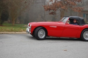 John drives his Austin Healey 100.