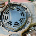 Picture of pull starter cover with location of fueltank screws
