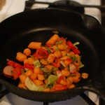 Vegetables stir fried in a cast iron skillet