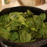 Meat and vegetables set aside, spinach added to hot pan
