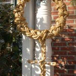 Picture of braided rope wreath with cross finish underneath