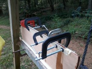 Picture of tape fences and  epoxy-filled clamped gap.